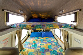 Colorful double-deck beds of Endeavour Campervan from Hippie Campers