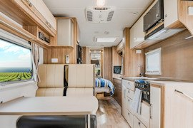 Dining in Conquest Royale from Let's Go Motorhomes Hire