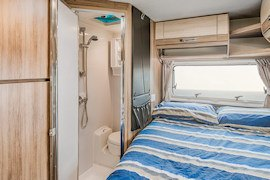 Bed area inside Jayco Conquest from Let's Go Motorhomes