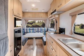 Dining area inside Jayco Voyager from Let's Go Motorhomes