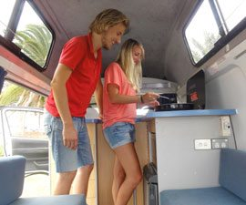 Campers enjoy cooking inside Kuga from Travellers Autobarn